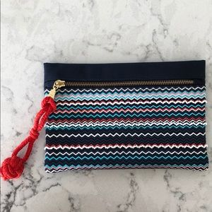 Navy blue clutch with colourful accents